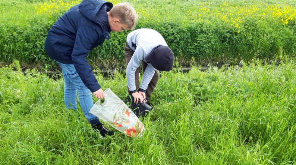 Lars en Stein in actie tijdens geocaching